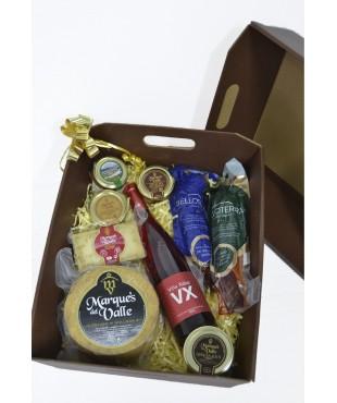 Lote nº 12: Caja con varios quesos, cremas,  lomo y vino